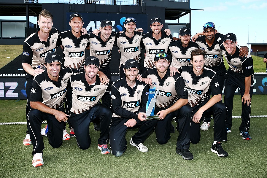 MOUNT MAUNGANUI, NEW ZEALAND - JANUARY 08: The New Zealand team pose for a photo with the series trophy after winning the third Twenty20 International match between New Zealand and Bangladesh at Bay Oval on January 8, 2017 in Mount Maunganui, New Zealand.  (Photo by Anthony Au-Yeung/Getty Images)
